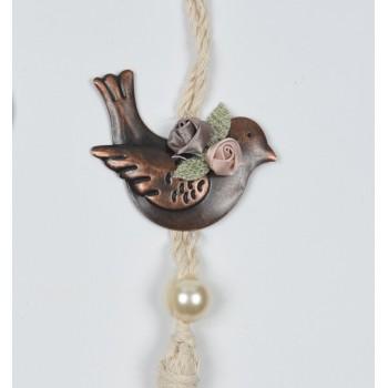 Μεταλλικό πουλί στολισμένο